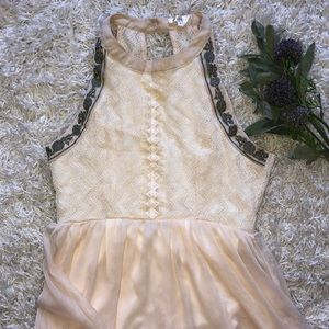 Cream open back buckle dress